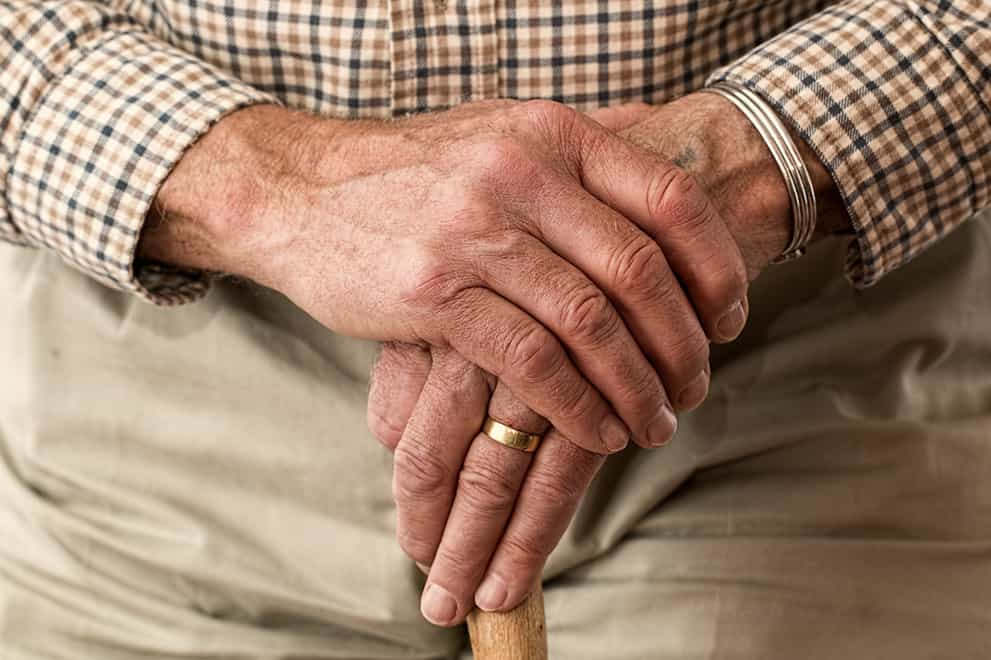 """An image a older man's hand holding a cane to represent """"Elder & Special Needs Law Services in Waynesville NC"""" symbolically"""