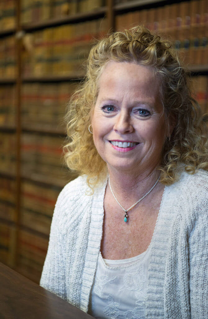 A photo of Waynesville, NC paralegal, Susan Purvis. Which works for real estate attorneys, Woodrow H. Griffin and Brian P. Schaefer.